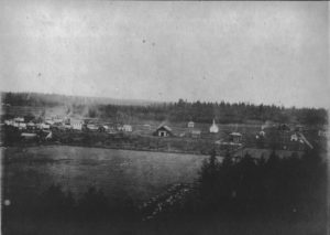 1887 photo of Newberg. The Minthorn house is at the far left.