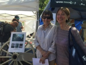 Colonial Dames provide information about the Hoover-Minthorn House Museum during the Festival.